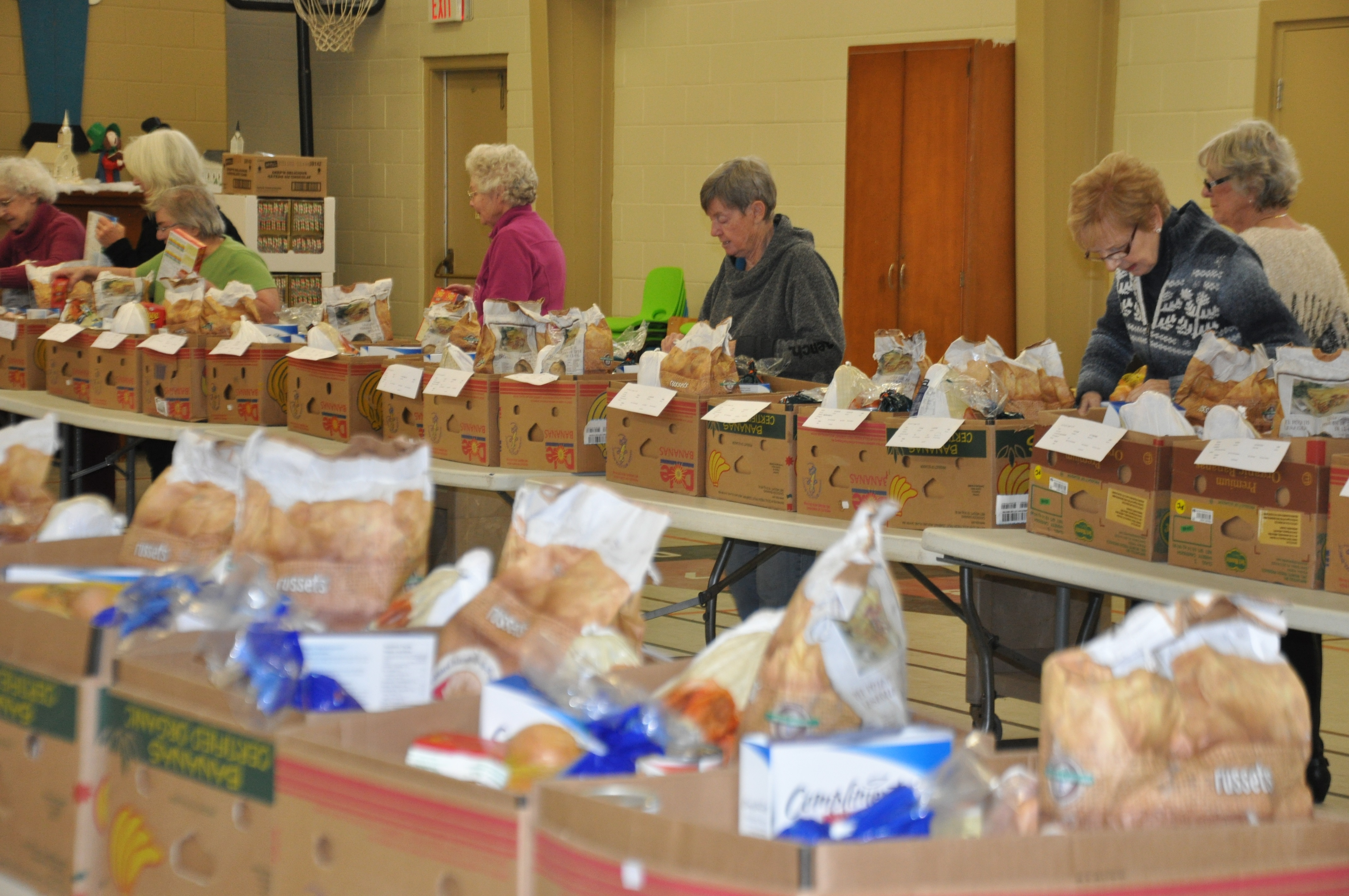 packing Christmas food baskets at Crossroads, 2017